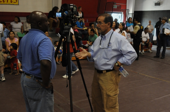 FEMA PIO with TV Reporter at Community Meeting